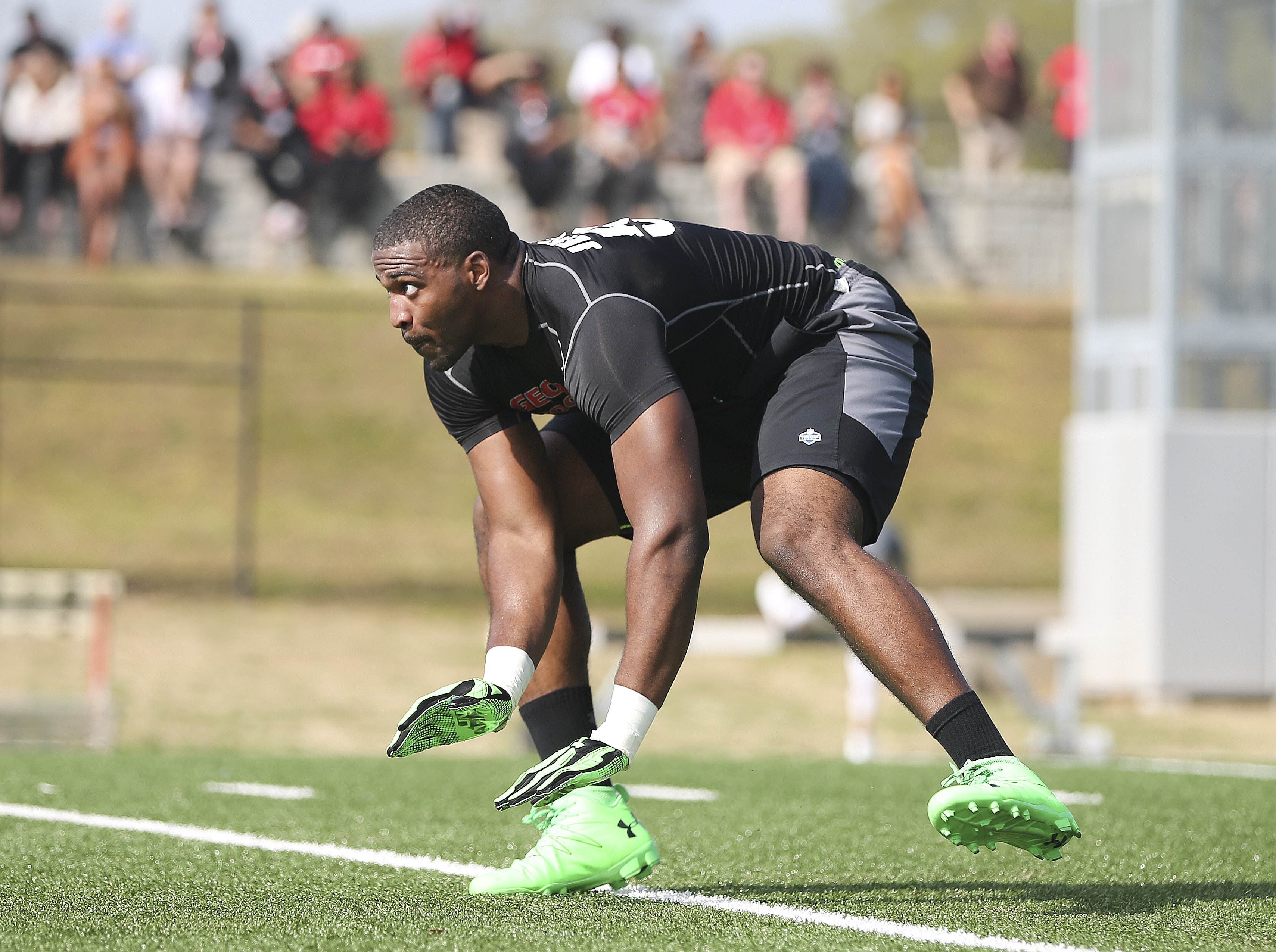 Linebacker Jordan Jenkins works during a drill in front of NFL football scouts during Georgia's Pro Day, Wednesday, March 16, 2016, in Athens, Ga. (John Bazemore/Associated Press)