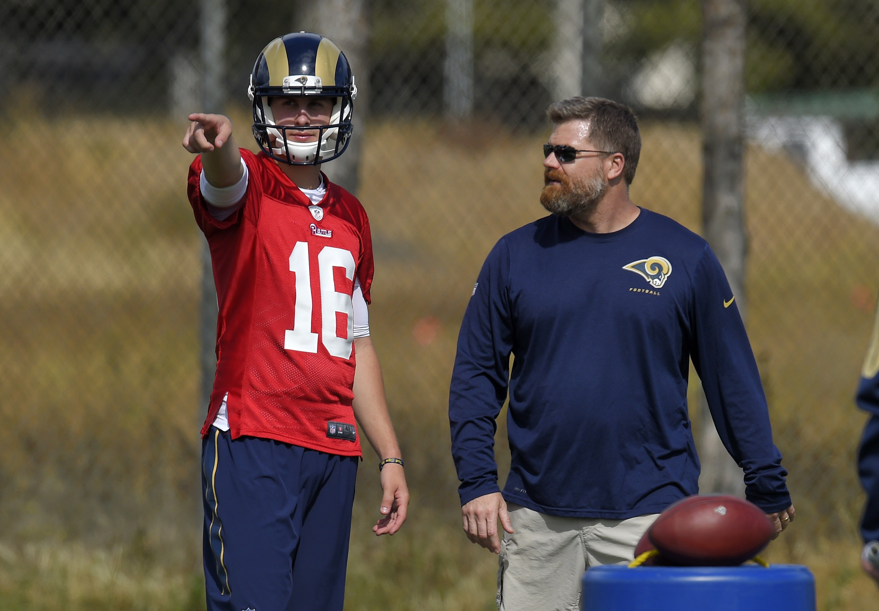 Los Angeles Rams quarterback Jared Goff, left, talks with offensive coordinator Rob Boras during Rams rookie minicamp, Friday, May 6, 2016, in Oxnard, Calif. (AP Photo/Mark J. Terrill)