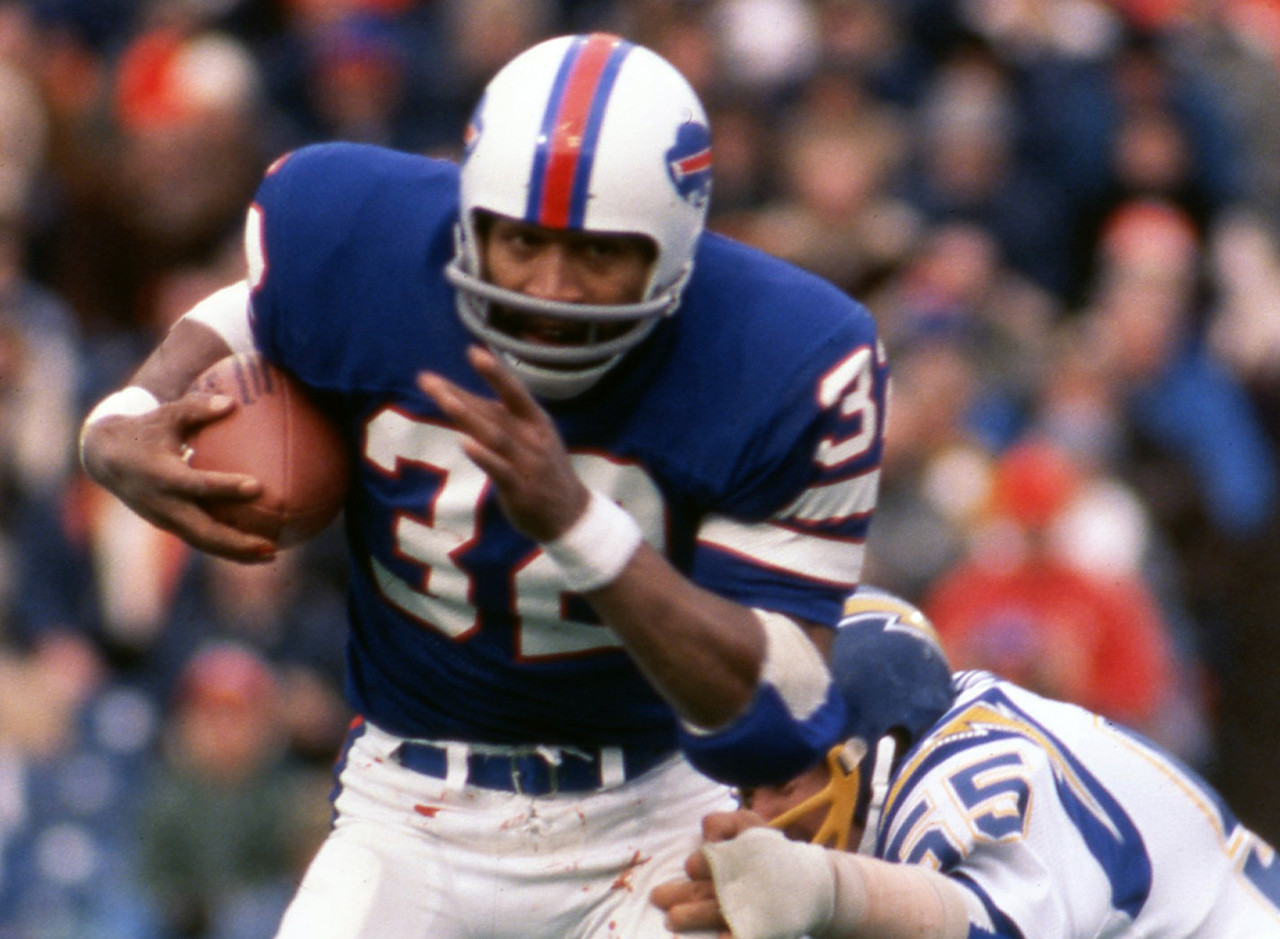 <b>Drafted by:</b> Buffalo Bills, 1969.<br /> <br /> Simpson didn't hit his stride with the Bills until Lou Saban took over head-coaching duties in 1972. Simpson led the NFL in rushing in four of the next five seasons, with a career-high 2,003 yards in 1973.