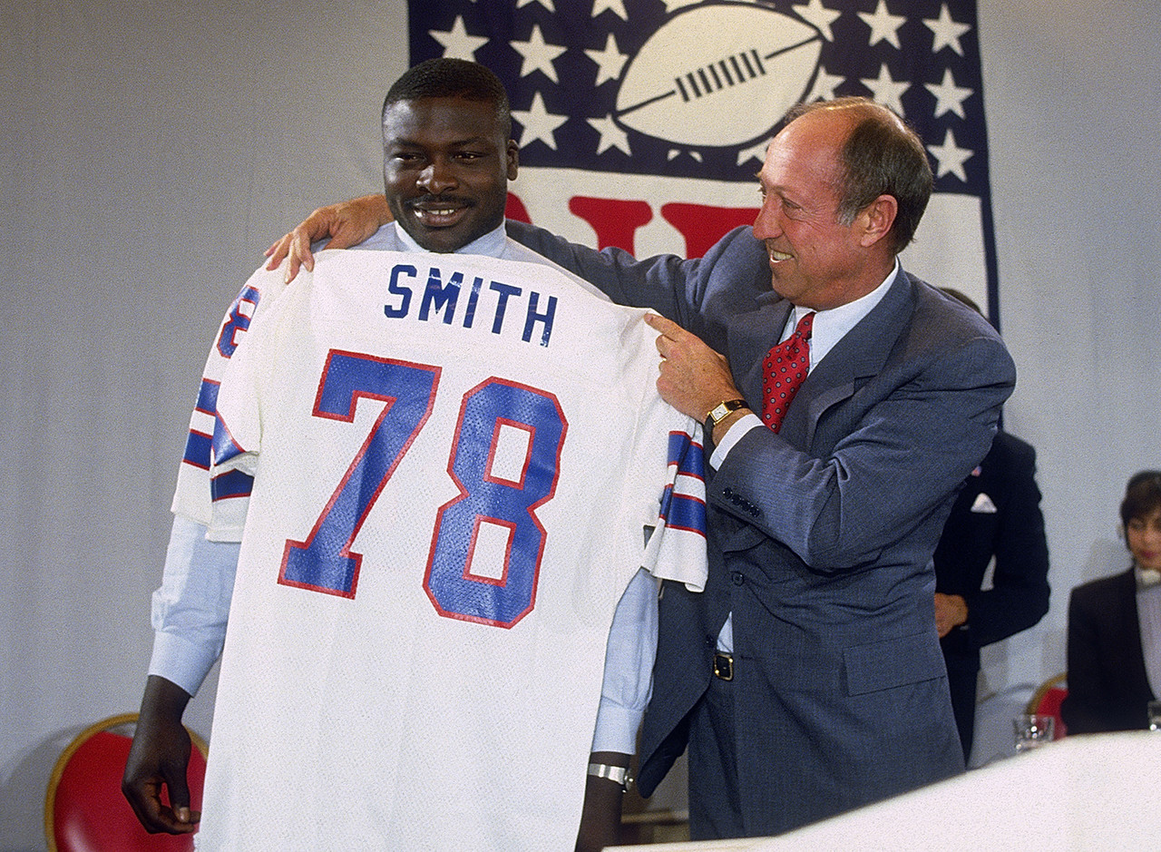 <b>Drafted by:</b> Buffalo Bills, 1985.<br /> <br /> The NFL's sack king deserves this high ranking, especially because Smith provided 15 Hall of Fame seasons for the team that drafted him. Hard to believe now, but people questioned the Bills' decision back in 1985. Smith's 200 sacks are beyond question, as are his eight first-team All-Pro selections and 11 Pro Bowl nods. Oh, he also was Defensive Player of the Year twice and was named to two different All-Decade teams by the Hall of Fame. So basically, he deserves to be above all the quarterbacks on this list. Except one.