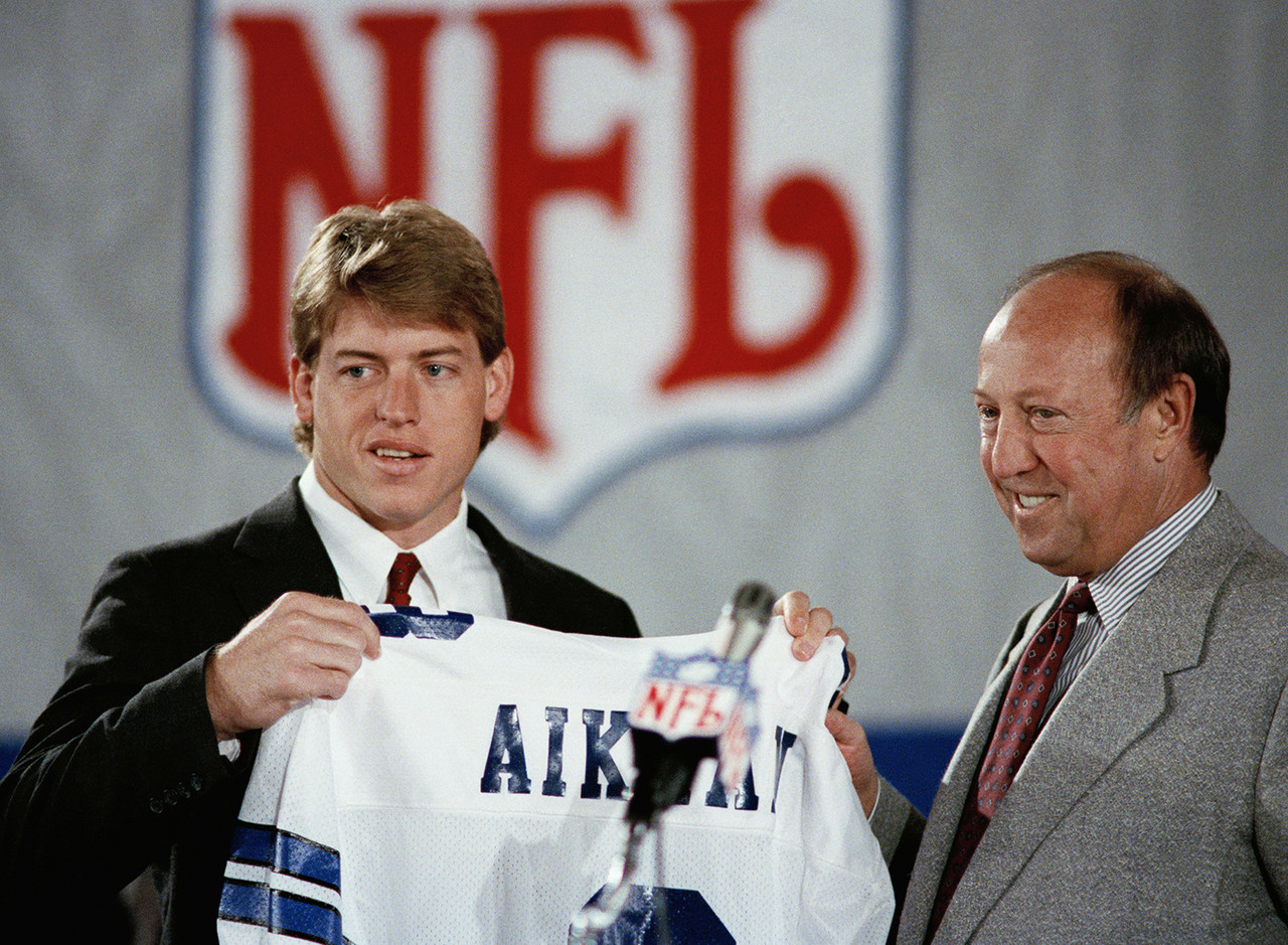 <b>Drafted by:</b> Dallas Cowboys, 1989.<br /> <br /> Hard to believe that it was 30 years ago when Aikman was drafted first overall by the Dallas Cowboys. Aikman was the first-ever draft pick by Jimmy Johnson and Jerry Jones. After beginning his career with 11 straight losses, Aikman would eventually start (and win) three Super Bowls. He also posted an 11-5 playoff record in the process. Many league observers consider him the most accurate intermediate thrower they've ever seen. His leadership? Off the charts.