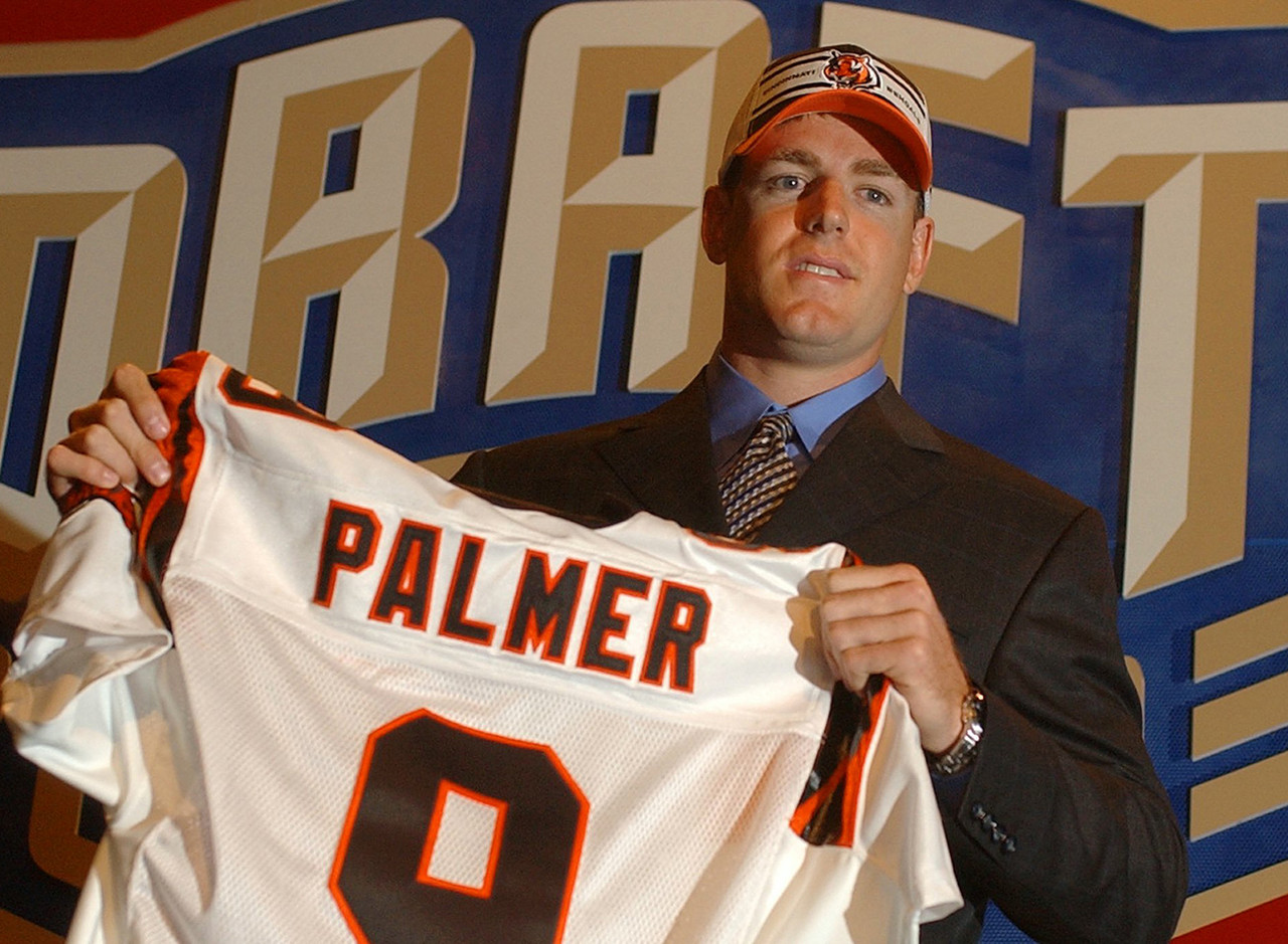 <b>Drafted by:</b> Cincinnati Bengals, 2003.<br /> <br /> Palmer sat his entire rookie season to learn, but by Year 3, he had the Bengals in the playoffs, with the promise of much more to come. However, injuries and inconsistent play marred much of Palmer's time in Cincy, which was followed by a sub-.500 two-year stint in Oakland (Palmer went 8-16 with the Raiders in 2011 and '12). He managed to be a more effective player under Bruce Arians in Arizona. Palmer's ability to throw a nice deep ball dovetailed with Arians' belief that routine checkdowns are as enjoyable as routine enemas.