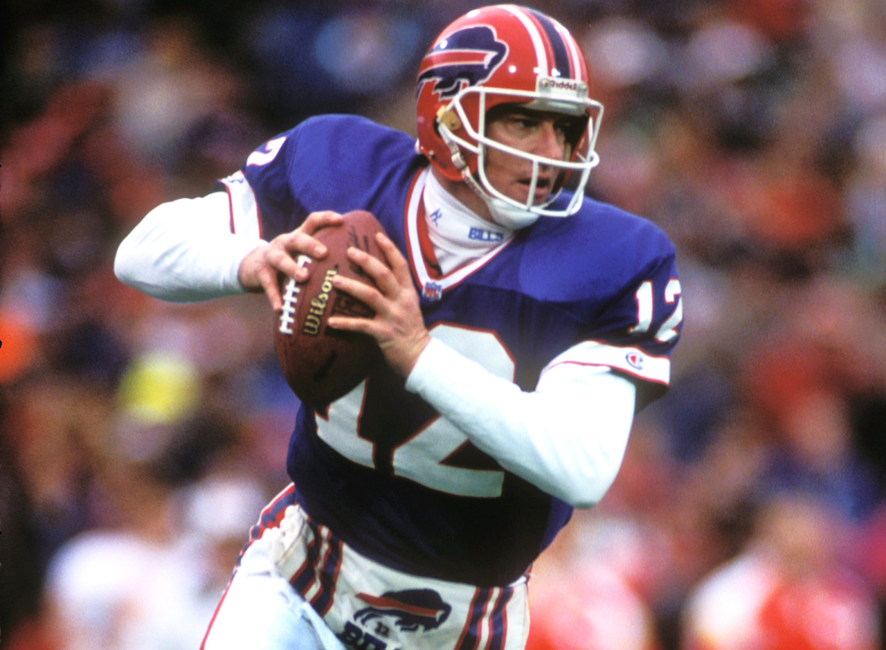 "<a href=""http://www.nfl.com/teams/profile?team=BUF"">Buffalo Bills</a>, 1986-1996<br> &raquo; Voted to Pro Bowl five times, First Team All-Pro once<br> &raquo; 35,467 career passing yards, 237 career touchdowns<br> &raquo; 101 career victories<br> &raquo; Enshrined in Pro Football Hall of Fame"