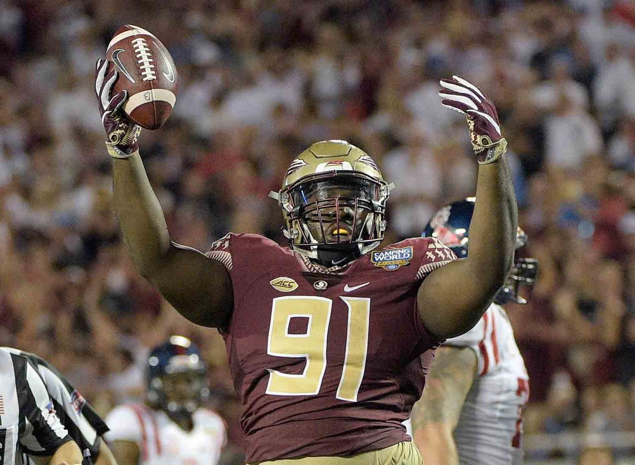 """Athletic nose tackle who should be able to play in odd or even fronts on the next level. Nnadi carries a low center of gravity that allows him to strike with """"low-man"""" pad level when he punches, providing him a good starting point at the point of attack when playing the run. His motor and plus awareness allow him to make more tackles than the average nose, and his six sacks last season are indicative of his willingness to play through the whistle."""