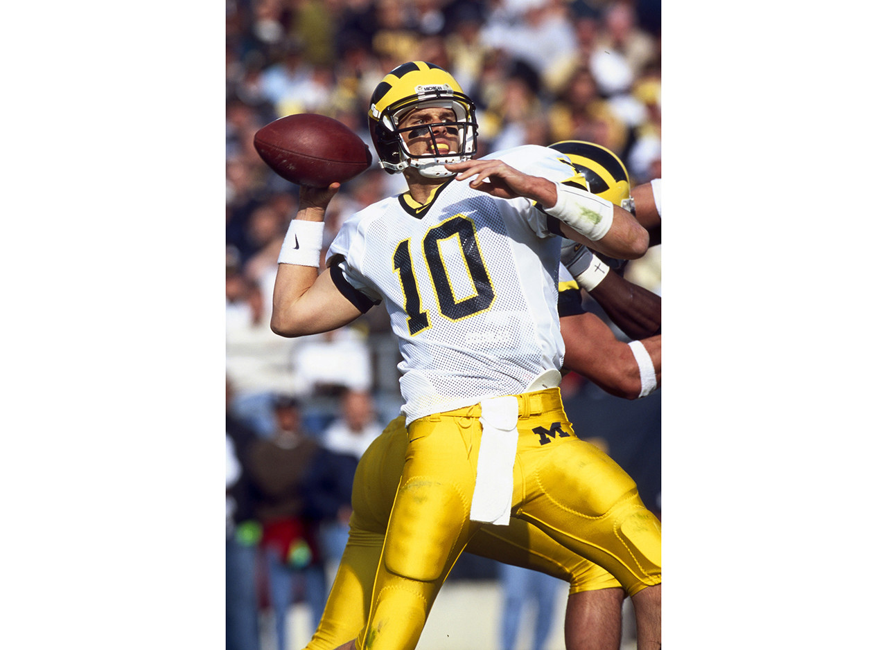 Quarterback Tom Brady of the University of Michigan Wolverines throws a pass in a 31 to 27 win over the Penn State University Nittany Lions on November 13, 1999 at Beaver Stadium in State College, Pennsylvania.