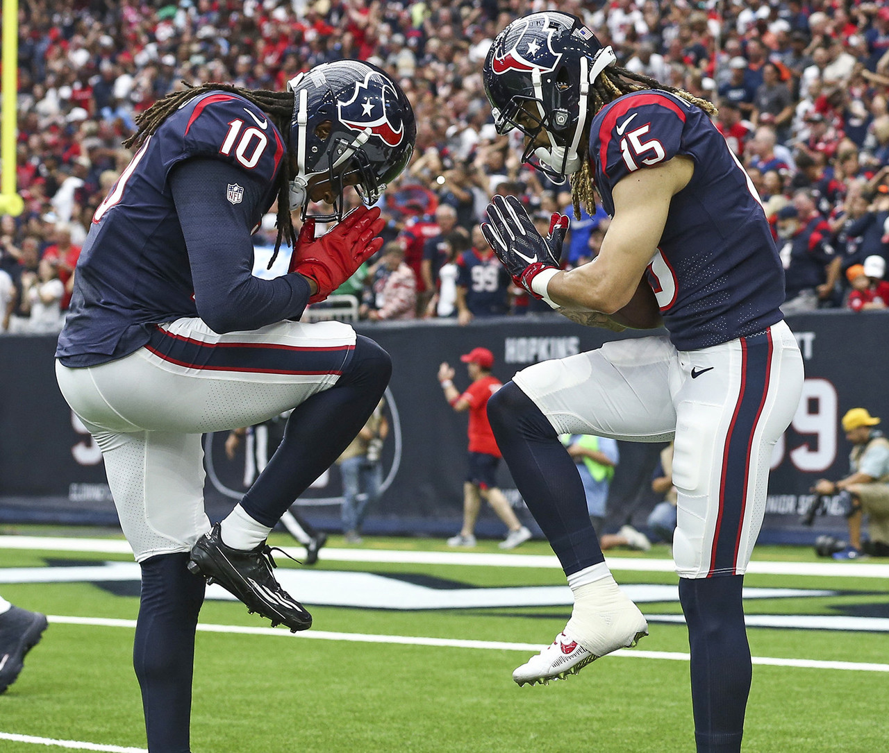 Houston Texans wide receiver Will Fuller (15) celebrates with wide receiver DeAndre Hopkins (10) after scoring a touchdown during the second quarter against the Tennessee Titans at NRG Stadium.