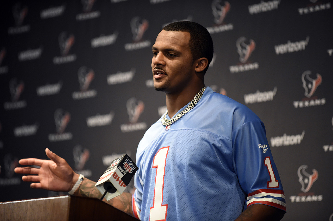Houston Texans quarterback Deshaun Watson, wearing a Warren Moon Houston Oilers jersey, responds to a question during a news conference after an NFL football game against the Cleveland Browns on Sunday, Oct. 15, 2017, in Houston.