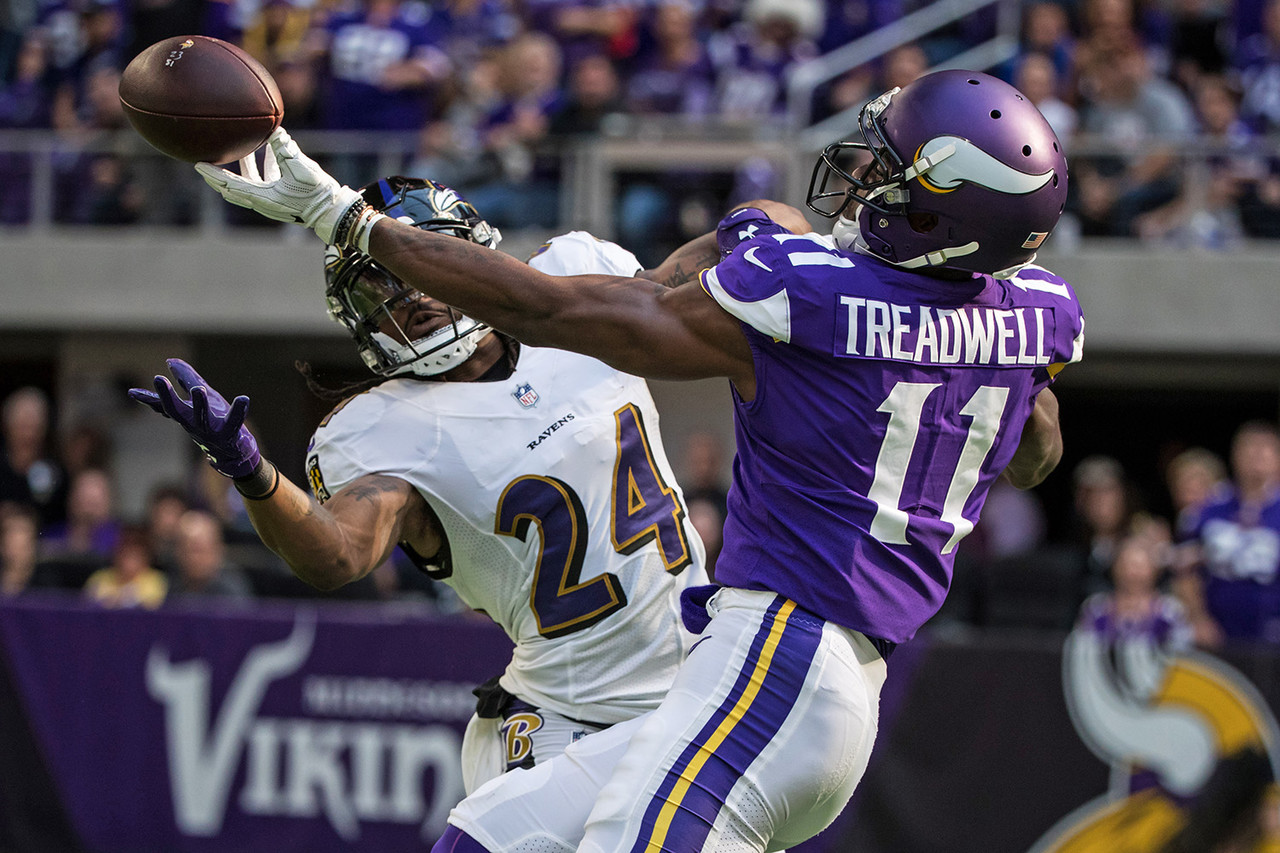 Baltimore Ravens cornerback Brandon Carr (24) intercepts a pass intended for Minnesota Vikings wide receiver Laquon Treadwell (11) during the first quarter at U.S. Bank Stadium.
