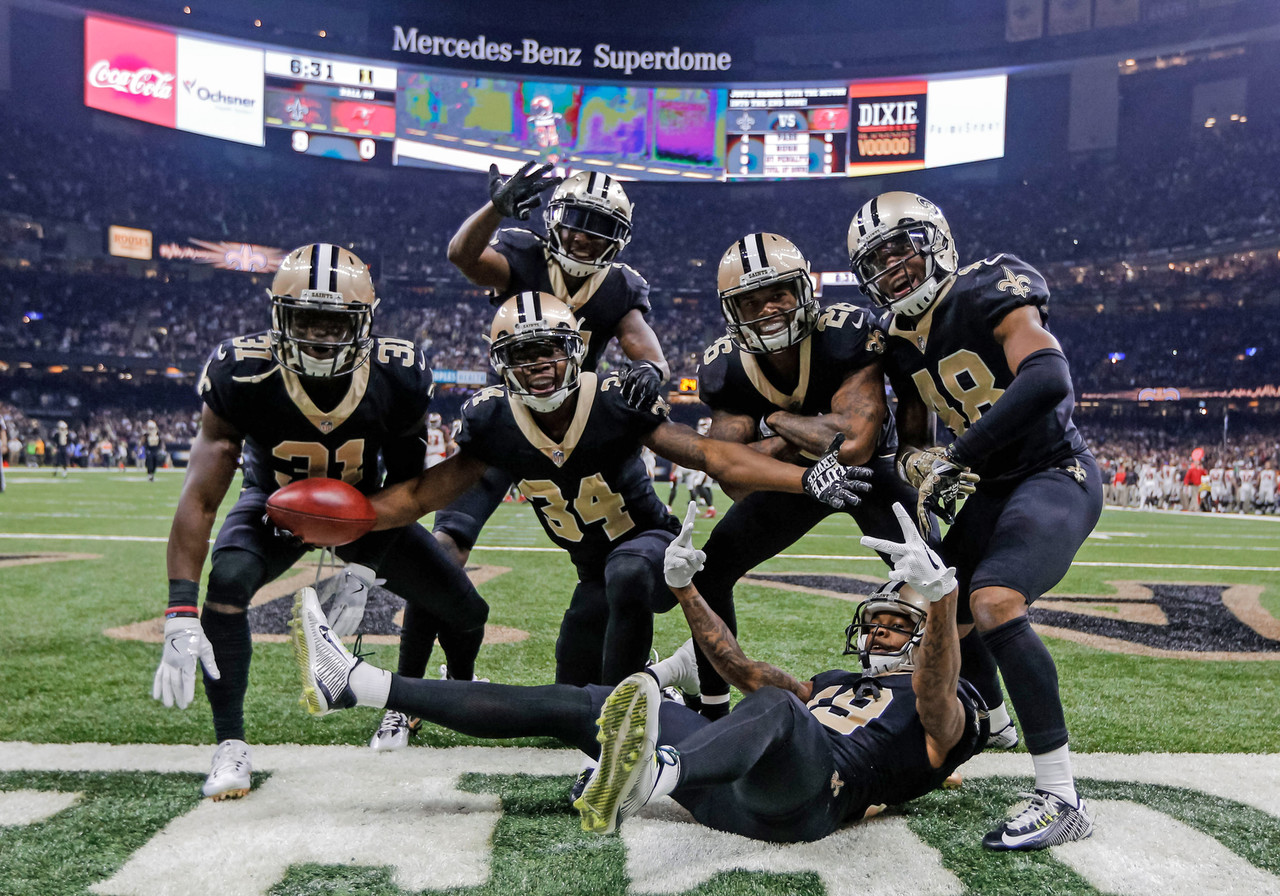 New Orleans Saints' Justin Hardee (center) celebrates with special teams teammates, posing for a photo in the endzone after a blocked punt for a touchdown against the Tampa Bay Buccaneers during the first quarter of a game at the Mercedes-Benz Superdome.