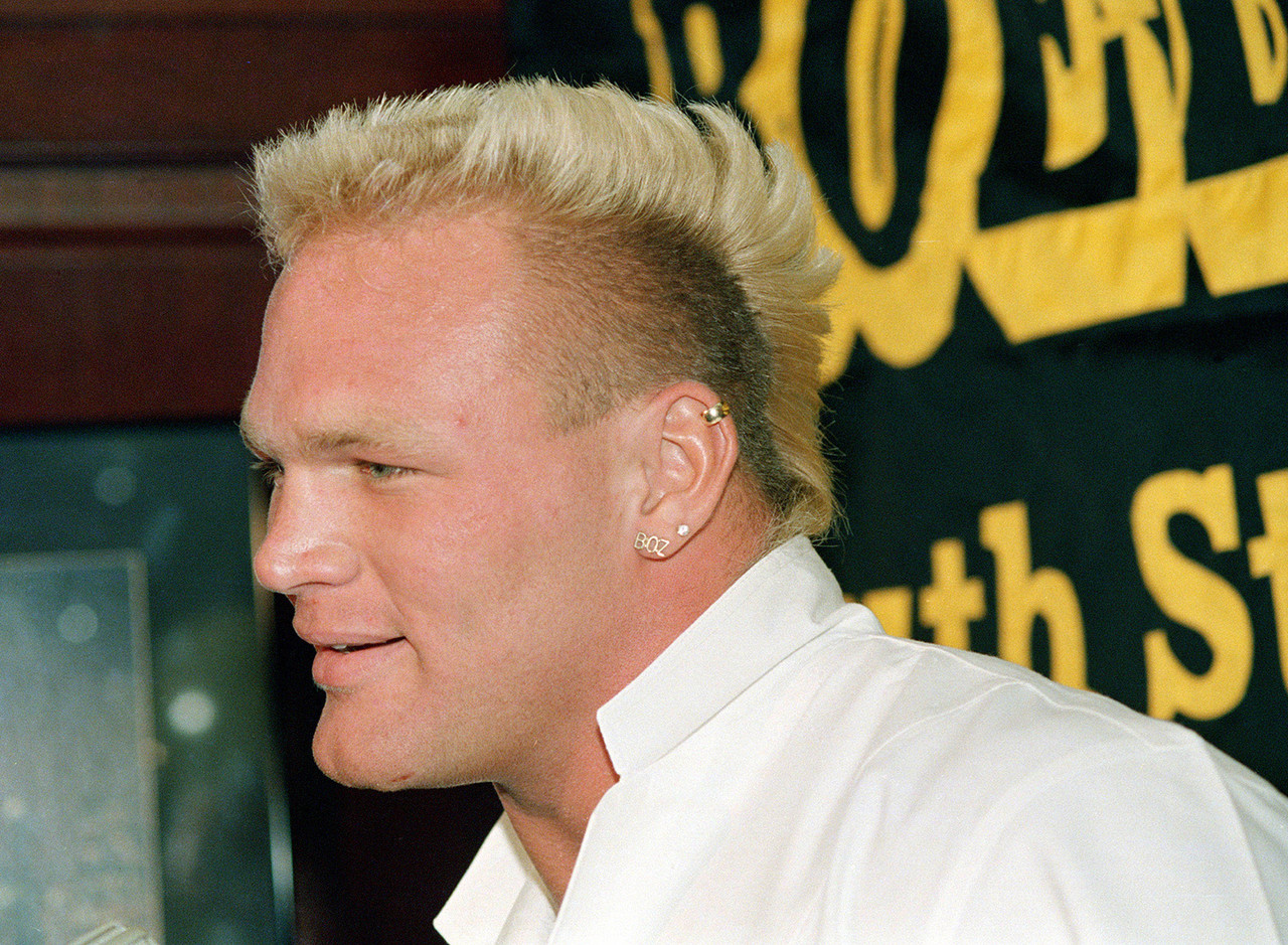 "Blond mohawk. Multiple earrings. In this photo, ""The Boz"" looks like he's going to beat up either The Karate Kid or Apollo Creed, so it's no surprise the Seahawks linebacker later found success as an actor, appearing in <i>Three Kings</i> and <i>The Longest Yard</i> remake, among others. Bosworth's football career was a brief bloom, but his big, trash-talking personality made him one of the most memorable NFL players in the '80s."