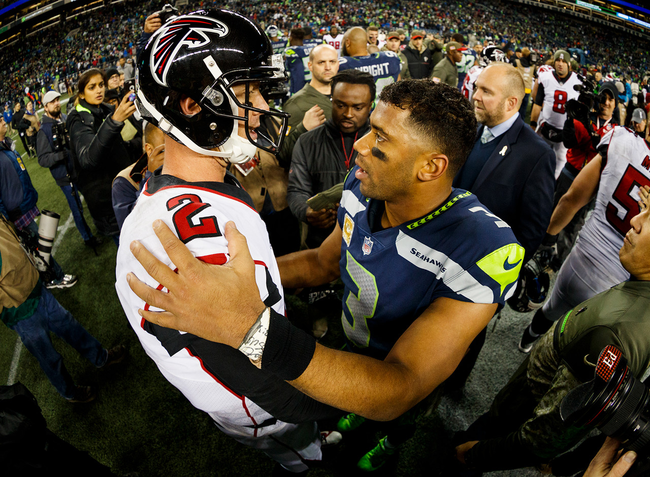 Atlanta Falcons quarterback Matt Ryan (2) and Seattle Seahawks quarterback Russell Wilson (3) meet after an NFL football game, Monday, Nov. 20, 2017, in Seattle. The Falcons defeated the Seahawks, 34-31.
