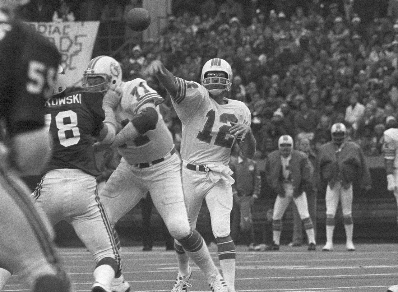 On Nov. 24, 1977, Miami Dolphins quarterback Bob Griese (12) passes during an NFL football game against the St. Louis Cardinals at St. Louis. The Dolphins set a Thanksgiving Day record by dropping 55 points on the Cardinals in 1977, as Griese threw for six touchdowns, a record that has since been tied by Peyton Manning.