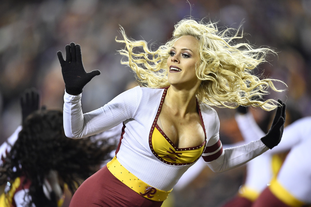 A Washington Redskins cheerleader performs during a NFL football game against the New York Giants on Thursday, November 23, 2017 in Landover, MD.