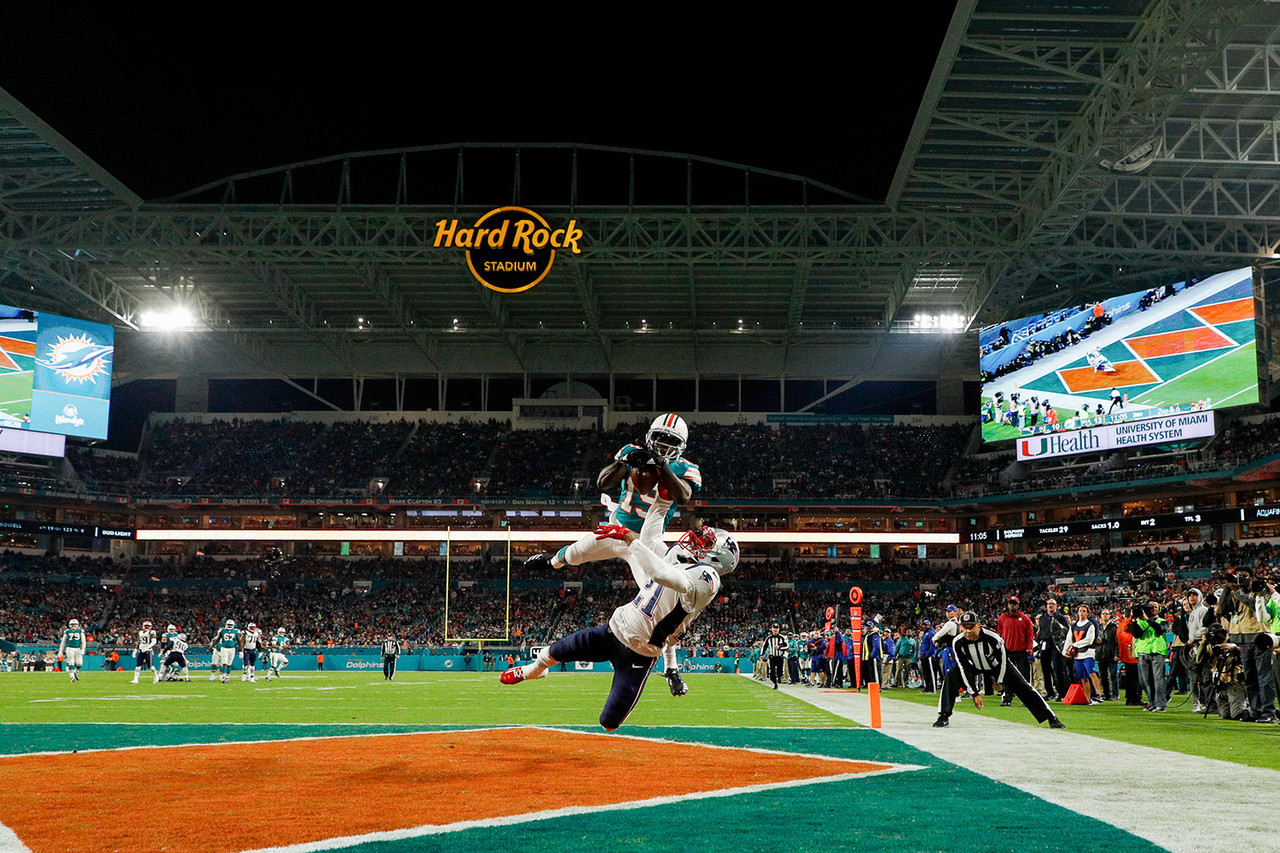 Miami Dolphins wide receiver Jakeem Grant (19) catches the ball for a touchdown in front of New England Patriots cornerback Malcolm Butler (21) during an NFL regular season football game and the Miami Dolphins on Dec. 11, 2017 in Miami.