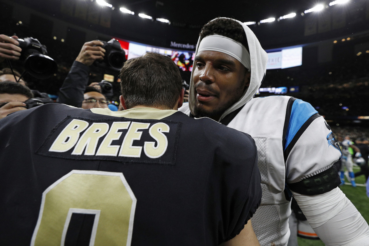 New Orleans Saints quarterback Drew Brees (9) and Carolina Panthers quarterback Cam Newton (1) shake hands following an NFL football wild card playoff game on Sunday, Jan. 7, 2018 in New Orleans.