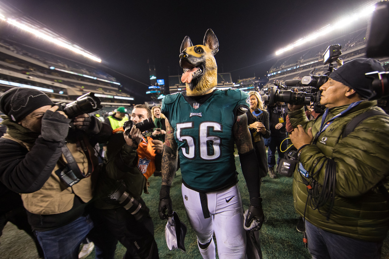 Philadelphia Eagles defensive end Chris Long (56) leaves the field wearing a dog mask in reaction to the Eagles being home under-dogs for their past two playoff games despite being the first seed after the NFC Championship Game against the Minnesota Vikings, Sunday, Jan. 21, 2018, in Philadelphia. The Eagles defeated the Vikings, 38-7.