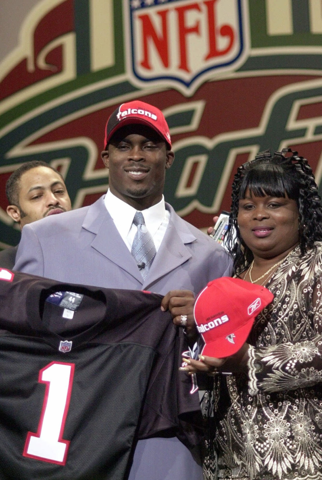 Quarterback Michael Vick, left, of Virginia Tech, poses with his mother Brenda Boddie, after he was selected by the Atlanta Falcons as the No. 1 overall pick in the NFL Draft Saturday, April 21, 2001, in New York.