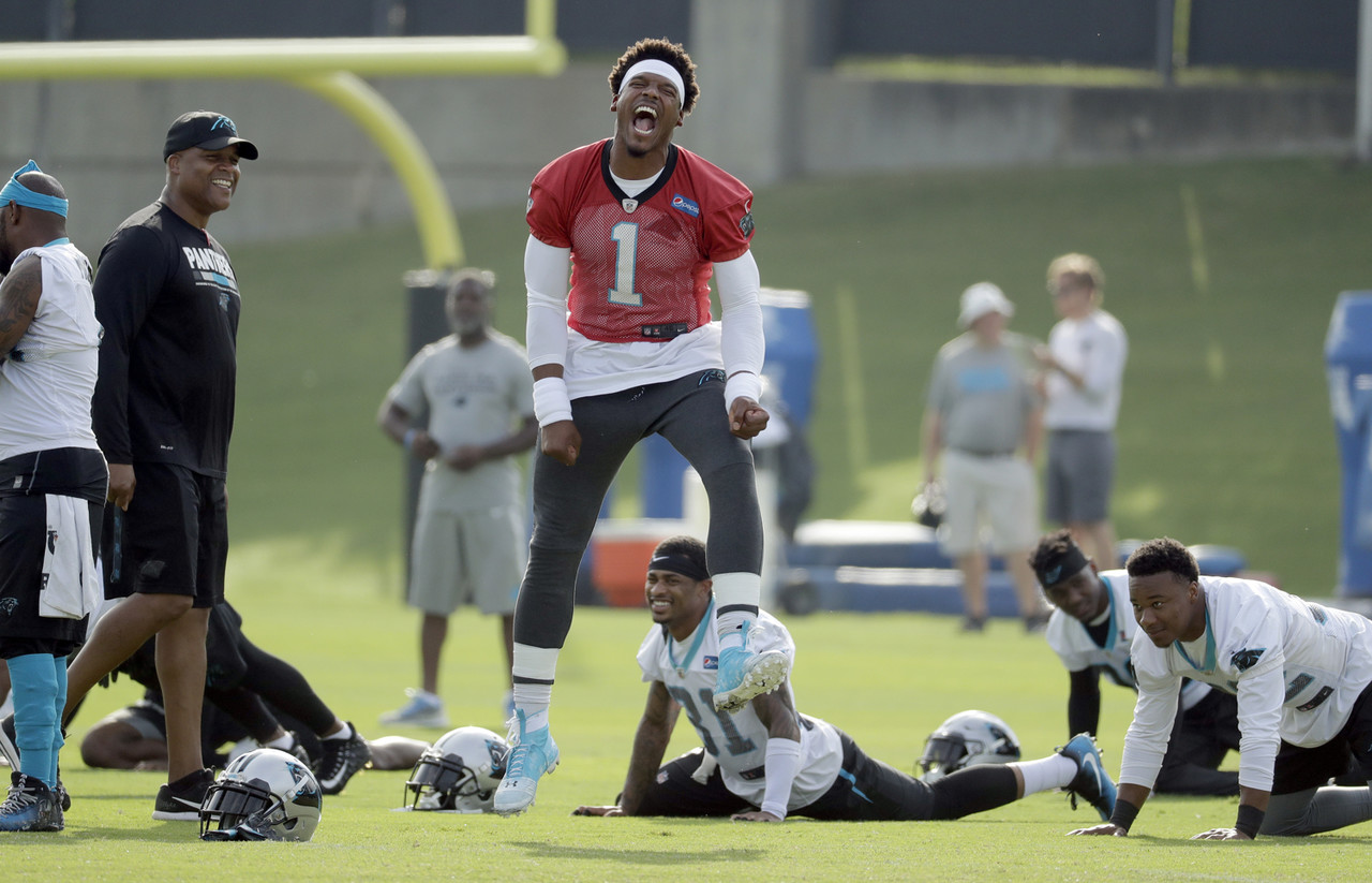 Carolina Panthers' Cam Newton (1) reacts as he jokes with players and coaches during the NFL football team's practice in Charlotte, N.C., Thursday, June 14, 2018.