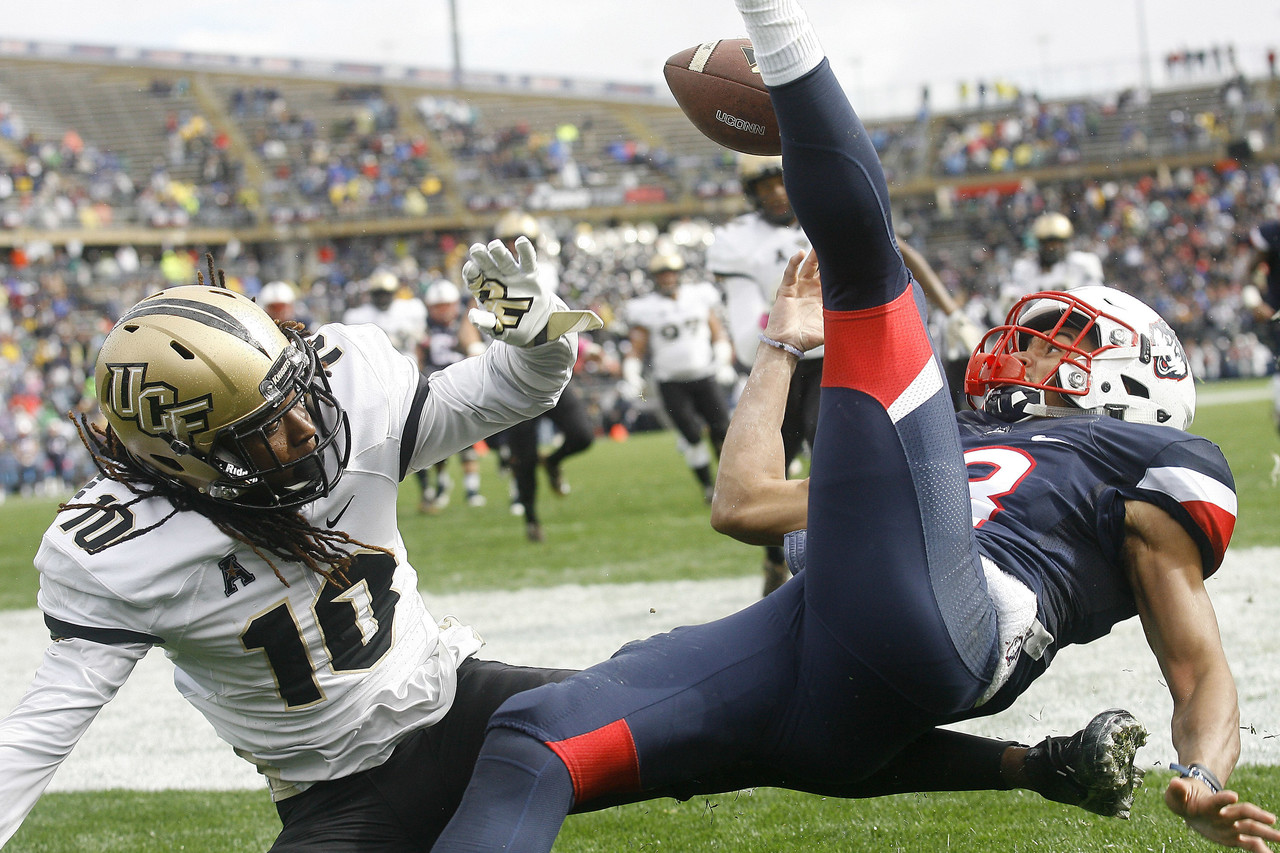 Central Florida defensive back Shaquill Griffin (10) breaks up a pass in the end zone intended for Connecticut wide receiver Brian Lemelle (18) during the first quarter of an NCAA football game Saturday, Oct. 22, 2016, in East Hartford, Conn.