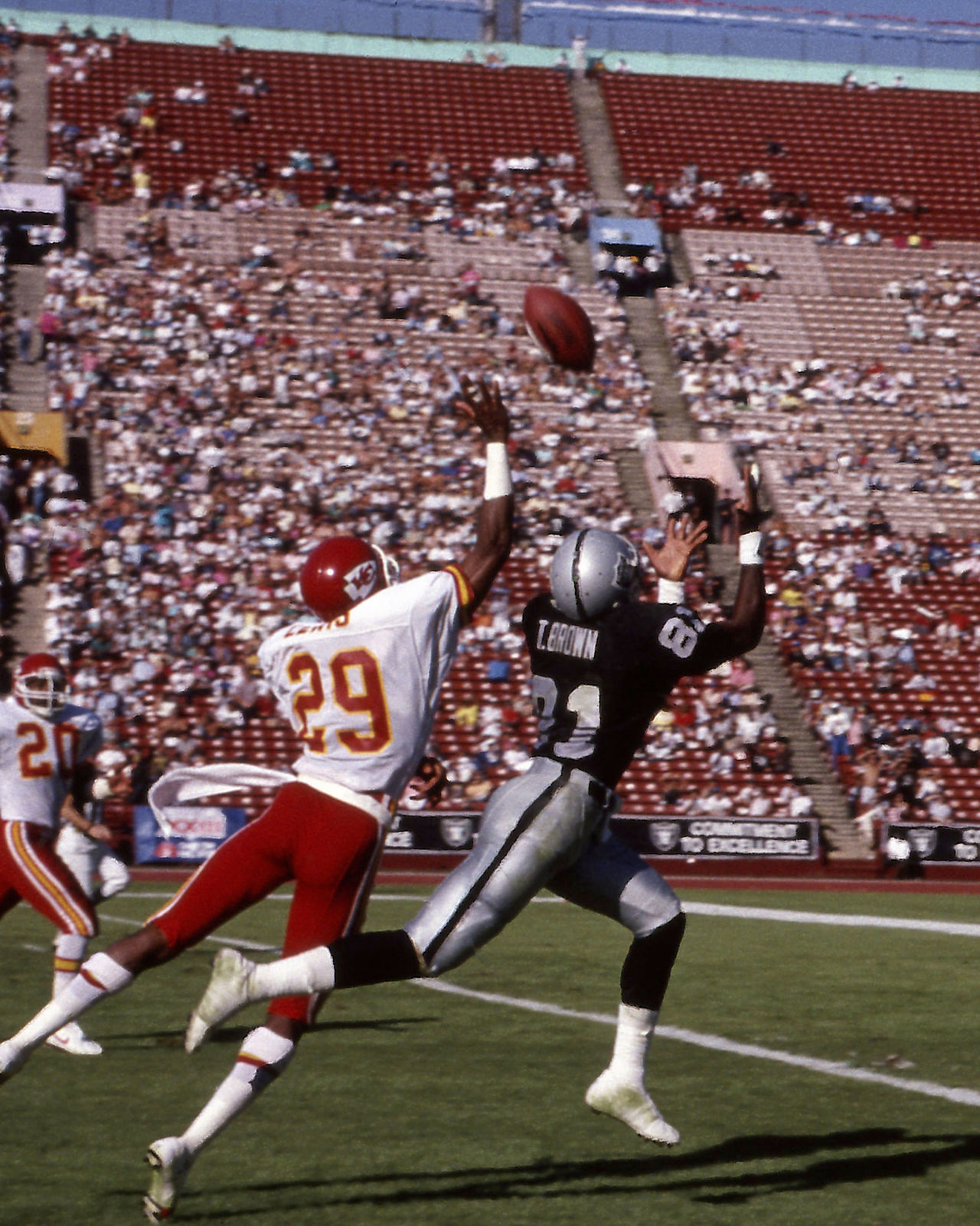 Los Angeles Raiders wide receiver Tim Brown (81)  beats Kansas City Chiefs cornerback Albert Lewis (29) for a pass during an NFL game in Los Angeles, Oct. 30, 1988.  The Raiders defeated the Chiefs 17-10.