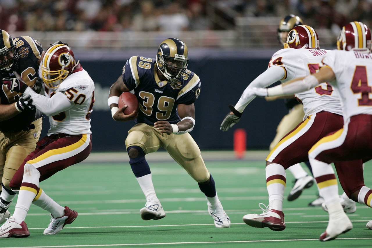 Steven Jackson of the St. Louis Rams runs for some of his 125 yards against the Washington Redskins at the Edwards Jones Dome in St. Louis, Missouri on August 27, 2004.  The Rams won 28-3.