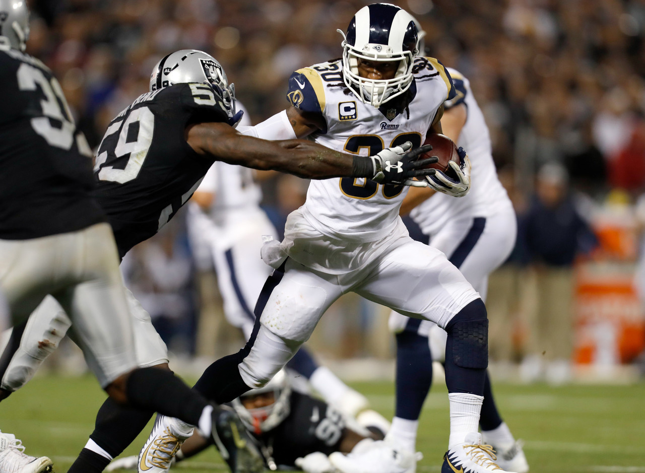 Los Angeles Rams running back Todd Gurley (30) pushes Oakland Raiders linebacker Tahir Whitehead (59) during an NFL football game against the Los Angeles Rams in Oakland, Calif., Monday, Sept. 10, 2018. (Ryan Kang/NFL)