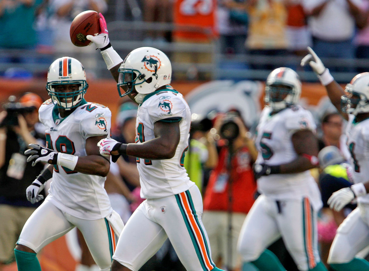 Miami Dolphins cornerback Vontae Davis, foreground, celebrates after scoring a touchdown following a 23-yard interception against the Buffalo Bills during an NFL football game in Miami, Fla., Sunday, Oct. 4, 2009.