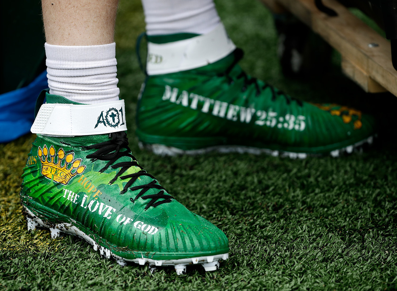 Philadelphia Eagles' Carson Wentz's cleats are seen during warmups before an NFL football game against the Indianapolis Colts, Sunday, Sept. 23, 2018, in Philadelphia.