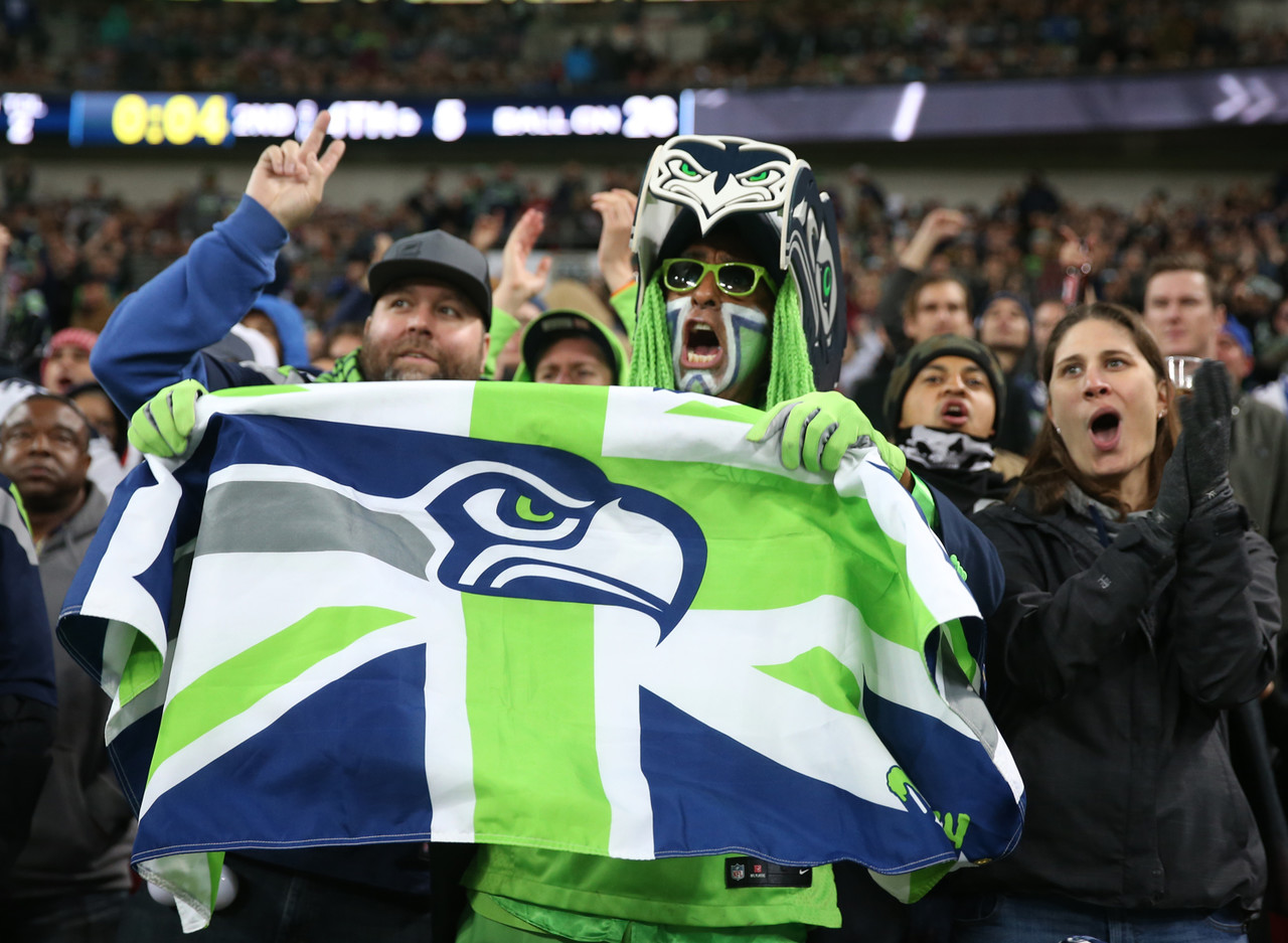 Seattle Seahawks fans cheer during an NFL football game against the Oakland Raiders at Wembley stadium in London, Sunday, Oct. 14, 2018.