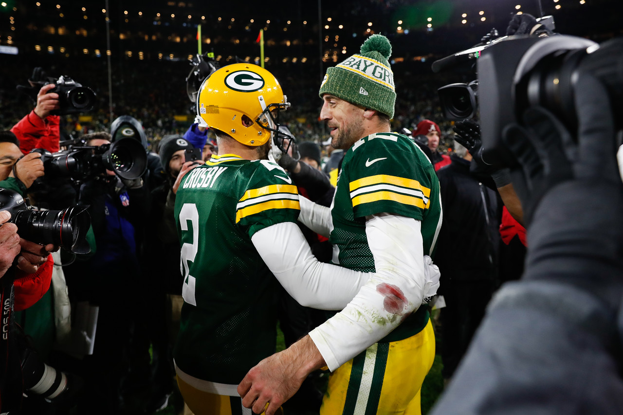 Green Bay Packers kicker Mason Crosby (2) hugs quarterback Aaron Rodgers (12) after kicking the winning field goal following an NFL football game against the San Francisco 49ers on Monday, Oct. 15, 2018, in Green Bay, Wis. Green Bay won 33-30.