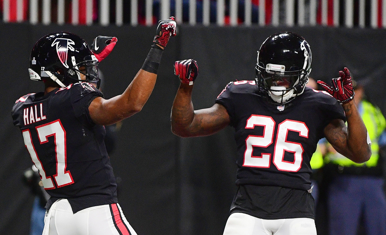 Atlanta Falcons wide receiver Marvin Hall (17) celebrates his touchdown with Atlanta Falcons running back Tevin Coleman during the first half of an NFL football game against the New York Giants, Monday, Oct. 22, 2018, in Atlanta.