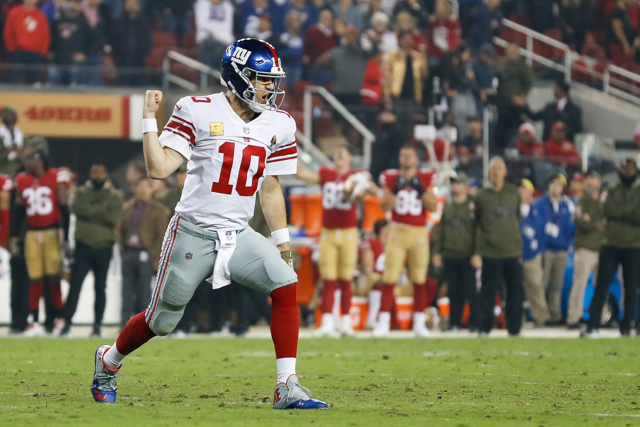 New York Giants quarterback Eli Manning (10) celebrates after throwing the game winning touchdown during an NFL football game against the San Francisco 49ers on Monday, Nov. 12, 2018, in Santa Clara, Calif.