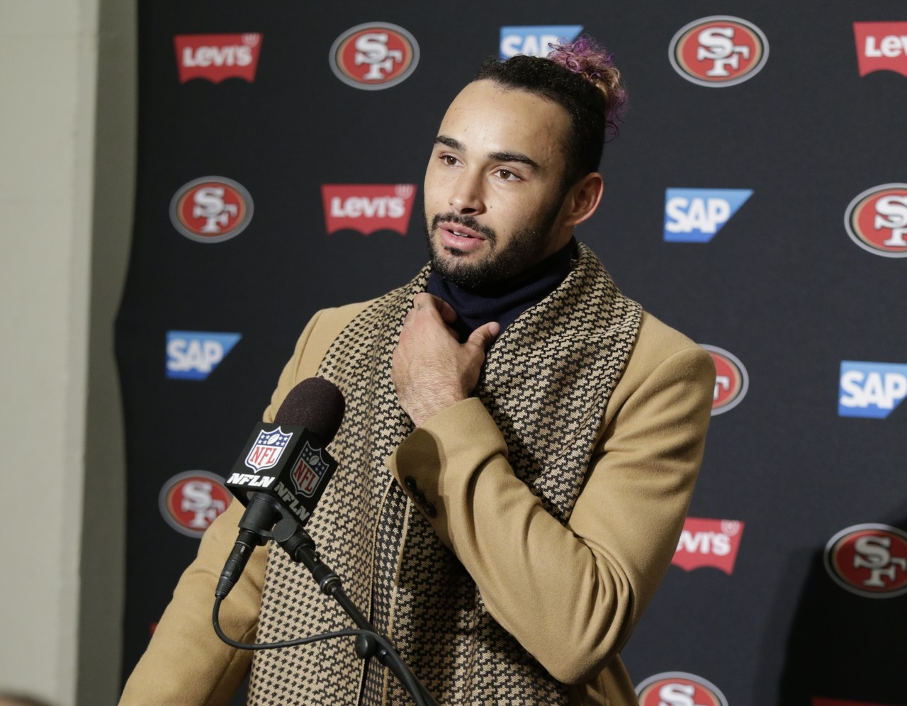 San Francisco 49ers wide receiver Dante Pettis talks to reporters following an NFL football game against the Seattle Seahawks, Sunday, Dec. 2, 2018, in Seattle. The Seahawks won 43-16.
