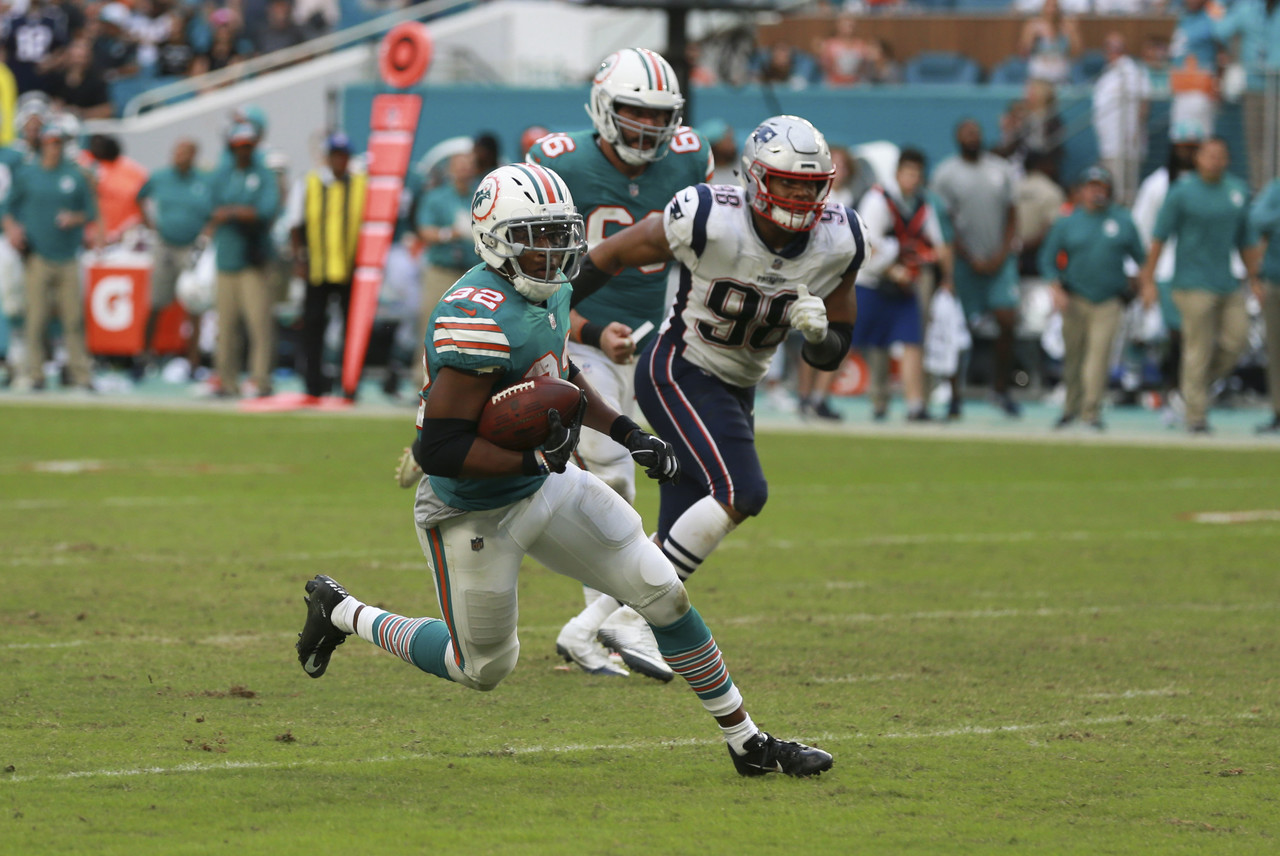 Miami Dolphins running back Kenyan Drake (32) runs for a touchdown during a NFL football game against New England Patriots, Sunday, Dec. 9, 2018, in Miami Gardens, FL.