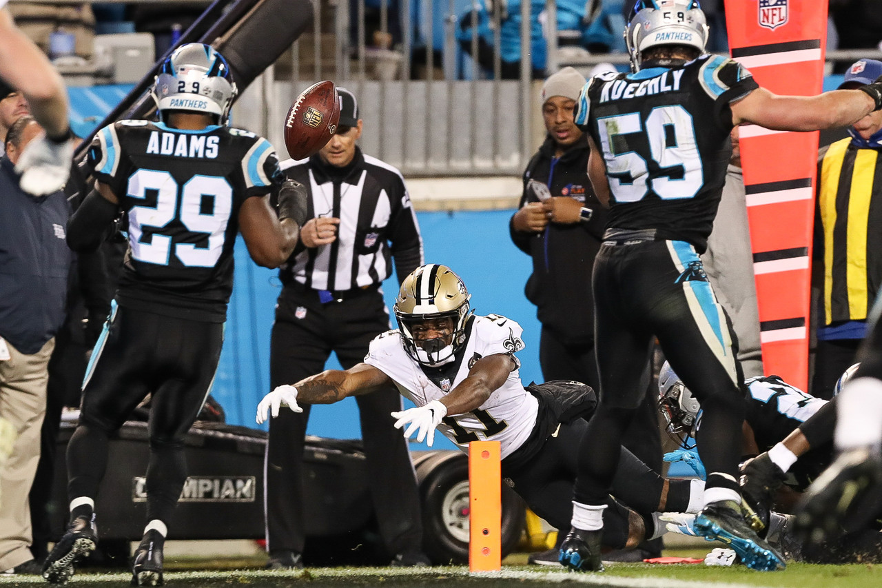 New Orleans Saints wide receiver Tommylee Lewis (11) fumbles the ball near the goal line for a turnover during an NFL football game against the Carolina Panthers on Monday, Dec. 17, 2018, in Charlotte, N.C.