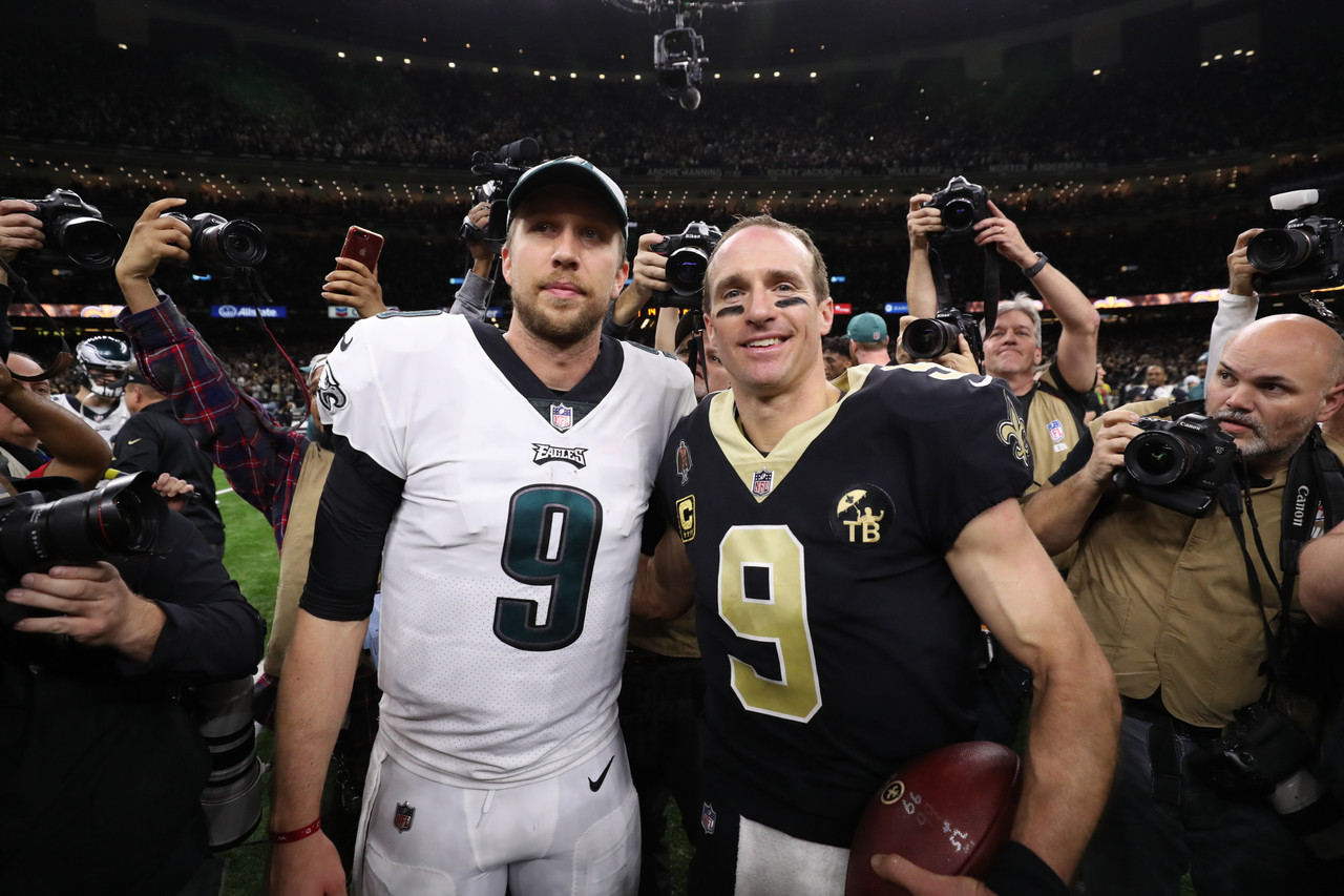 Philadelphia Eagles quarterback Nick Foles (9) and New Orleans Saints quarterback Drew Brees (9) pose for a photo following an NFL divisional playoff football game in New Orleans, Sunday, Jan. 13, 2019. The Saints won 20-14.