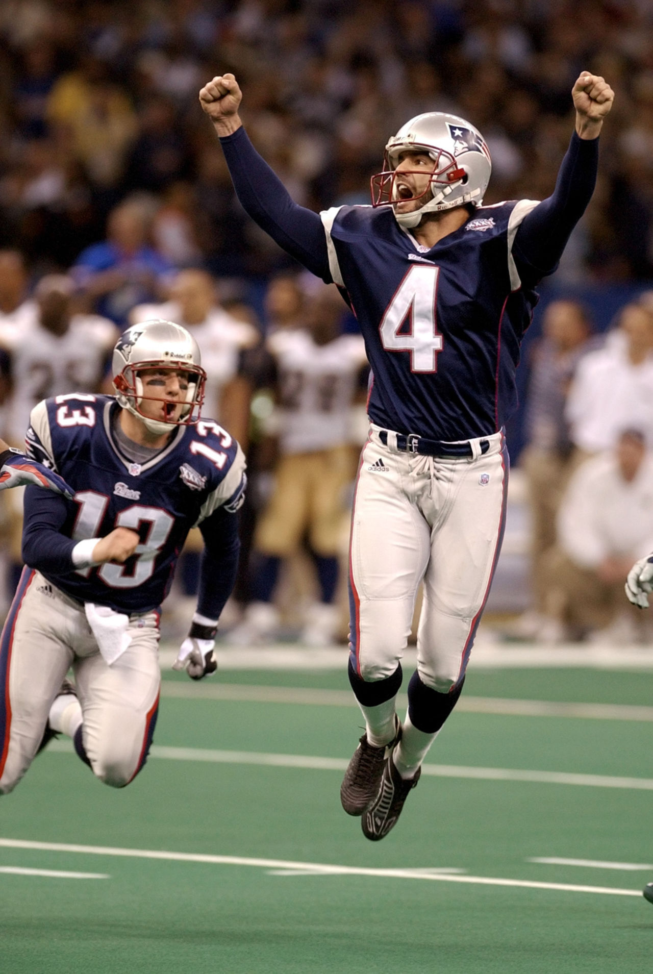 New England Patriots' kicker Adam Vinatieri celebrates his 48-yard game-winning field goal in the final seconds of Super Bowl XXXVI against the St. Louis Rams on Sunday, Feb. 3, 2002 in New Orleans. At left is teammate Ken Walters.