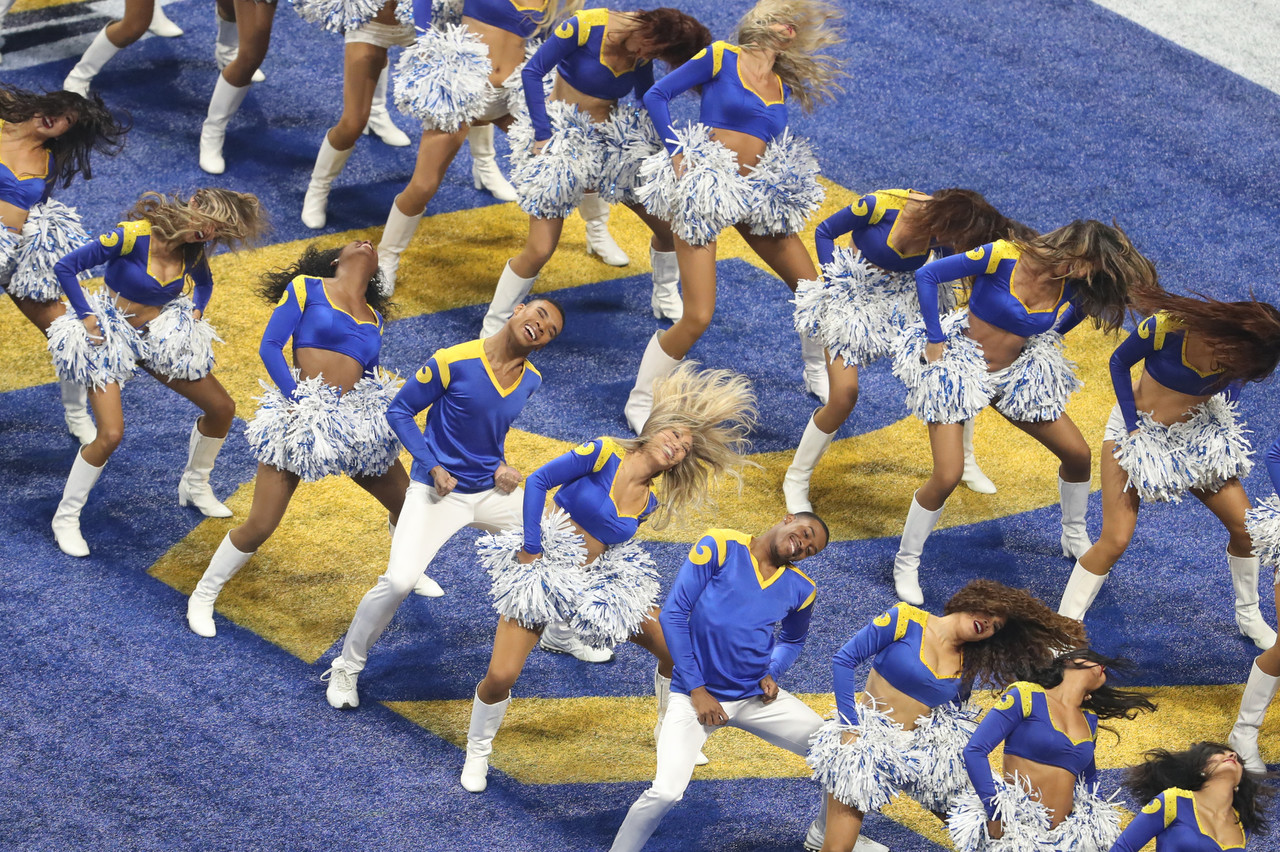 Rams cheerleaders, including Napoleon Jinnies and Quinton Peron, perform on the field during the NFL Super Bowl LIII football game between the New England Patriots and Los Angeles Rams, Sunday, Feb. 3, 2019 in Atlanta.