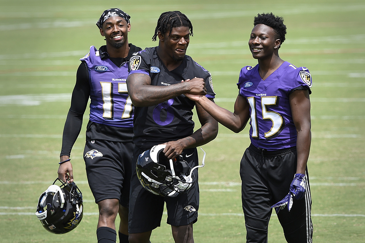 Baltimore Ravens quarterback Lamar Jackson, center, shakes hands with Marquise Brown after workouts at the team's NFL football training facility in Owings Mills, Md., Wednesday, June 12, 2019.