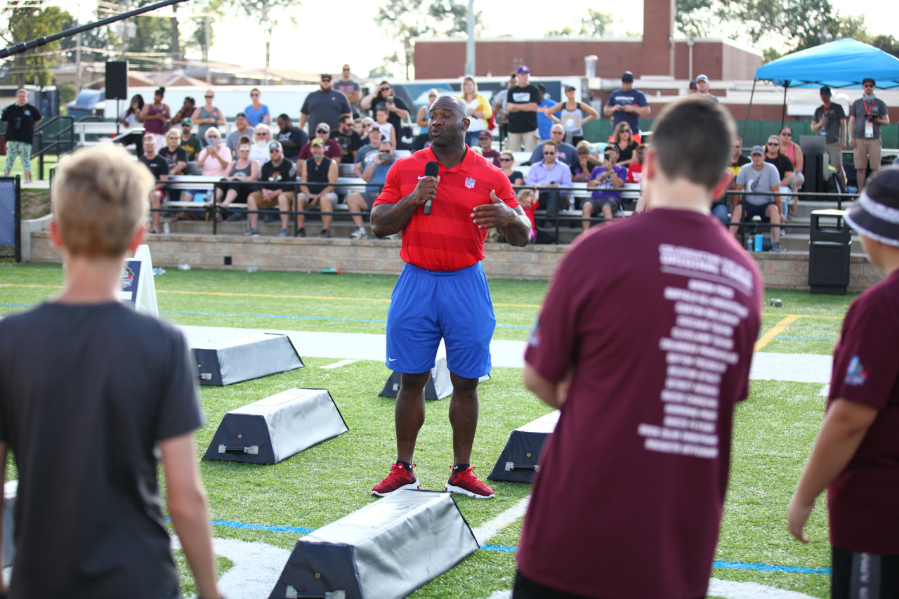 NFL Legend LeCharles Bentley talks to children ages 11-14 about the values learned from the game of football during the Play Football Skills Camp on July 31, 2019 in Canton, Ohio.