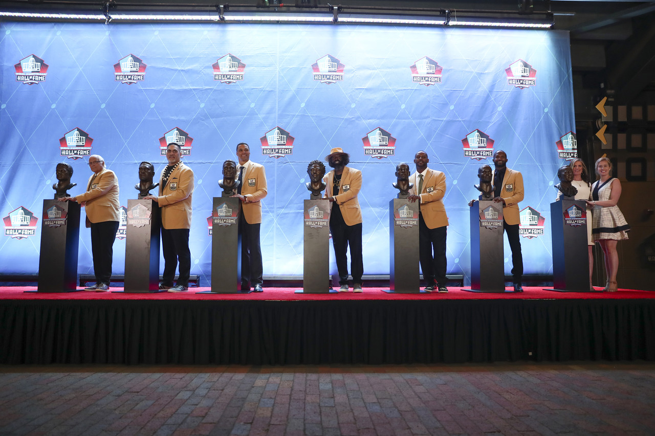 Hall of Famers Johnny Robinson, Kevin Mawae, Tony Gonzalez, Ed Reed, Ty Law, Champ Bailey and Pat Bowlen's daughters pose for photos with busts during the Pro Football Hall of Fame Enshrinement Ceremony on Saturday, August 3, 2019 in Canton, Ohio.