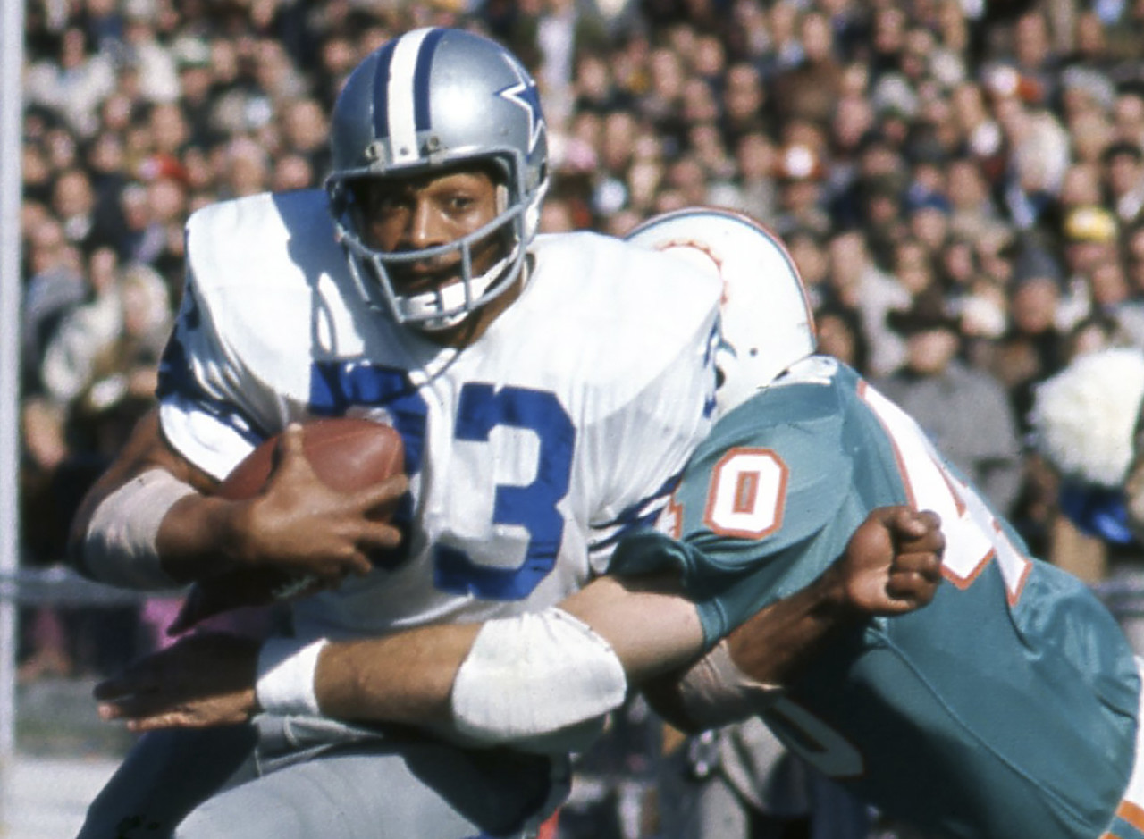Dallas Cowboys running back Duane Thomas (33) gets tackled by Miami Dolphins safety Dick Anderson (40) during Super Bowl VI on Jan. 16, 1972, at Tulane Stadium in New Orleans. The Dallas Cowboys defeated the Miami Dolphins 24-3.