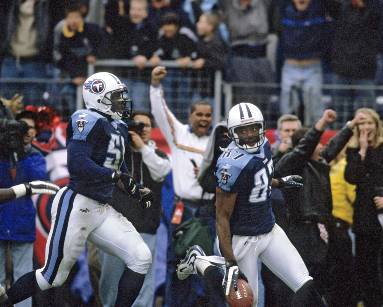 Tennessee Titans wide receiver Kevin Dyson (87) takes a kickoff return 75 yards for a touchdown during the AFC Wildcard Playoff, a 22-16 victory over the Buffalo Bills on January 8, 2000, at Adelphia Coliseum in Nashville, Tennessee.  The Bills scored a field goal with 16 seconds left in the game, seemingly putting the game out of reach.  On the ensuing kickoff, Titans fullback Lorenzo Neal fielded the ball and handed off to tight end Frank Wycheck, who then passed the ball to Dyson.  After a  review to verify that it was indeed a lateral and not a forward pass (which would have nullified the touchdown), the ruling on the field stood, and the so-called 'Music City Miracle' was born.