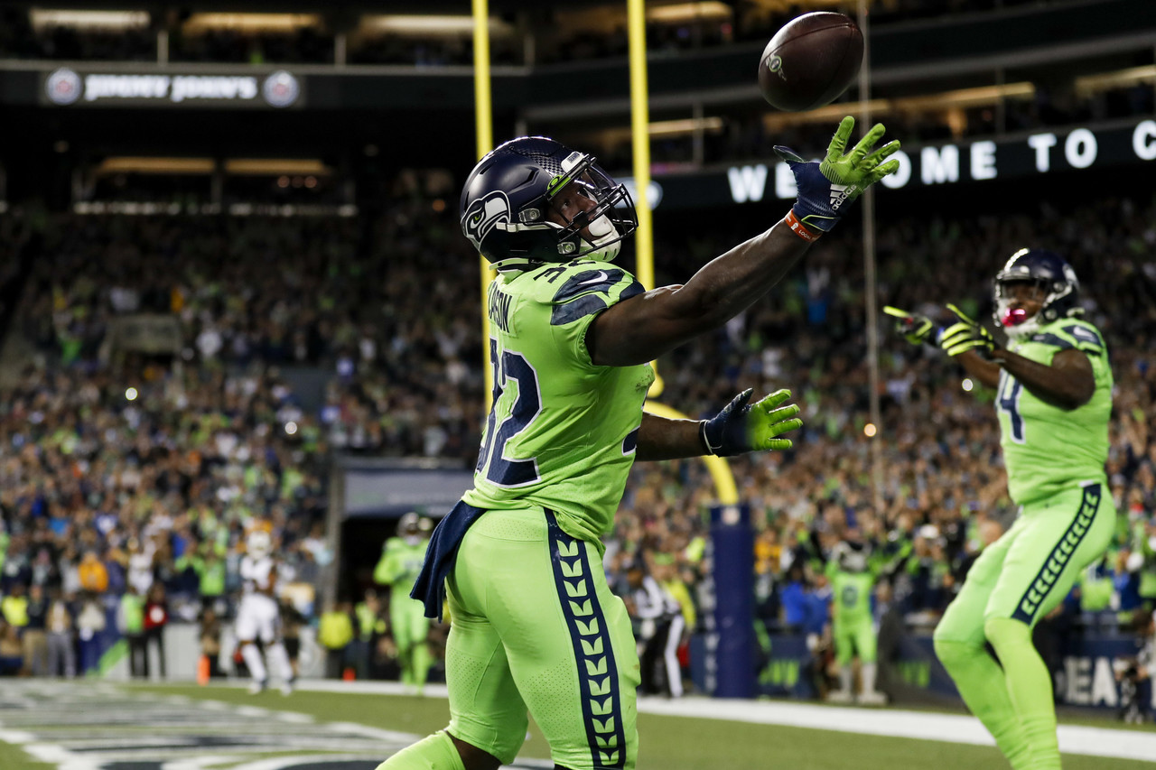 Seattle Seahawks running back Chris Carson (32) catches the ball in the end zone for a touchdown during an NFL football game against the Los Angeles Rams, Thursday, Oct. 3, 2019 in Seattle.