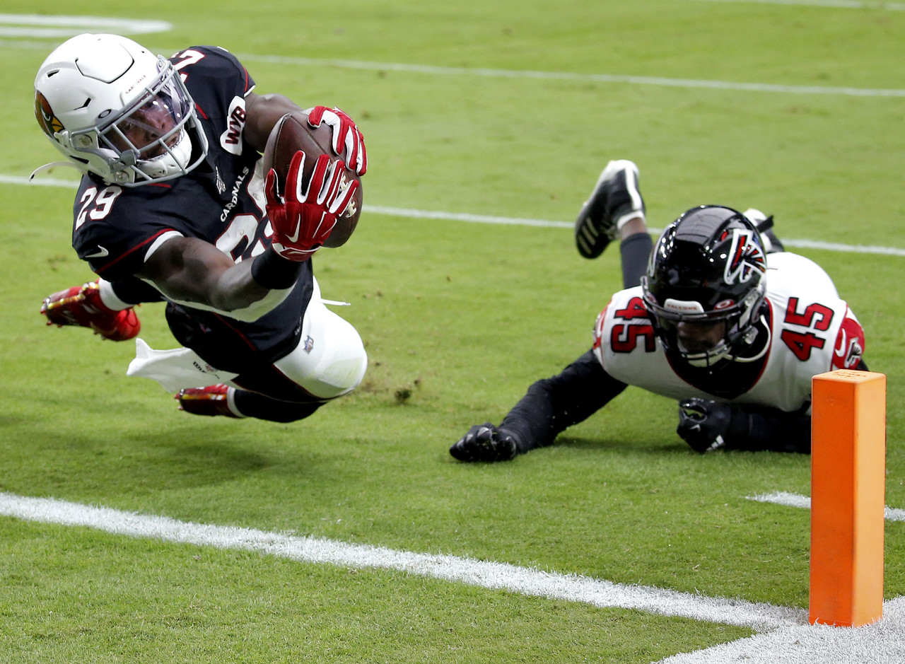 Arizona Cardinals running back Chase Edmonds (29) scores a touchdown as Atlanta Falcons linebacker Deion Jones (45) defends during the first half of an NFL football game, Sunday, Oct. 13, 2019, in Glendale, Ariz.