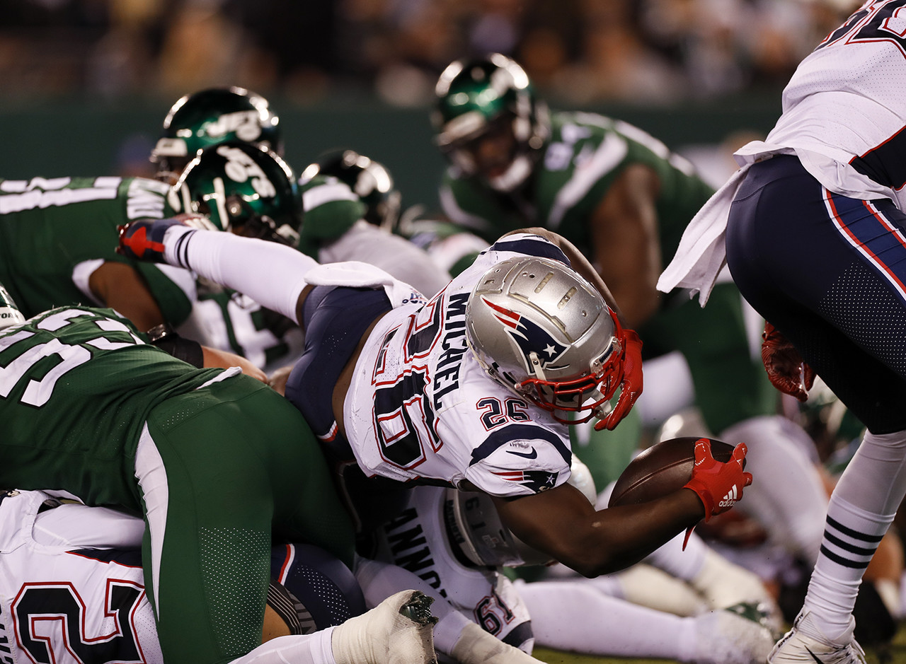 New England Patriots running back Sony Michel (26) dives for a touchdown during an NFL football game against the New York Jets, Monday, Oct. 21, 2019 in East Rutherford, N.J.