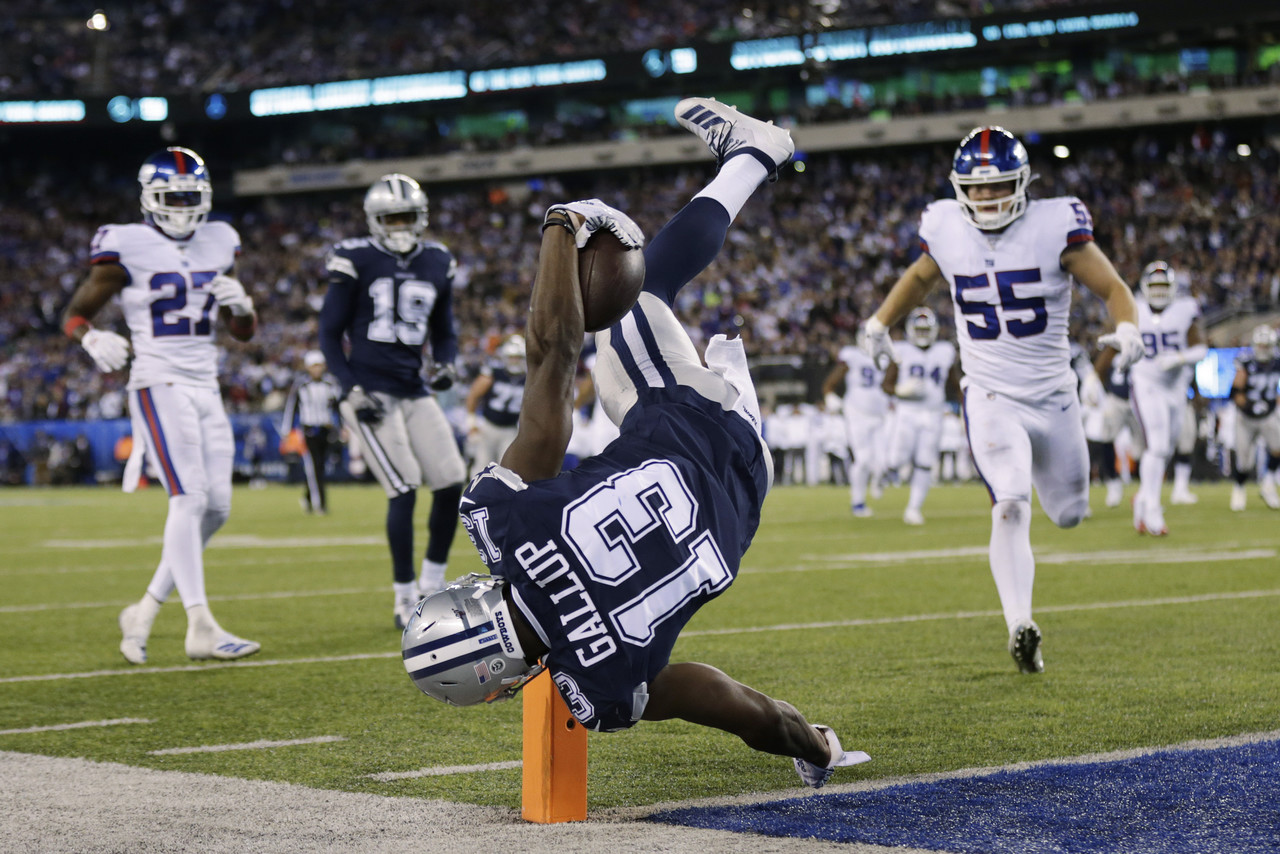 Dallas Cowboys wide receiver Michael Gallup (13) stays in bounds as he flips over the goal line to score a touchdown against the New York Giants during the fourth quarter of an NFL football game, Monday, Nov. 4, 2019, in East Rutherford, N.J. (AP Photo/Adam Hunger)