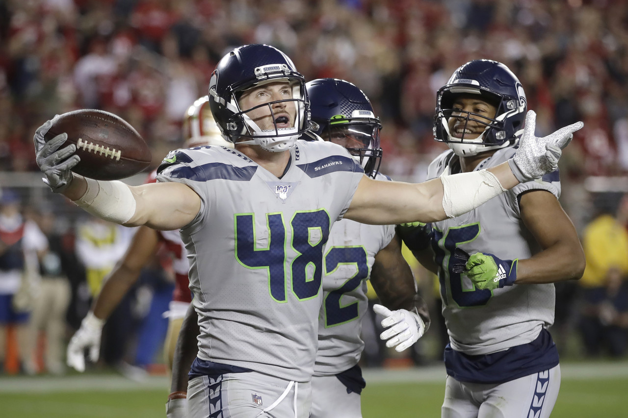 Seattle Seahawks tight end Jacob Hollister (48) celebrates after scoring against the San Francisco 49ers during the second half of an NFL football game in Santa Clara, Calif., Monday, Nov. 11, 2019.