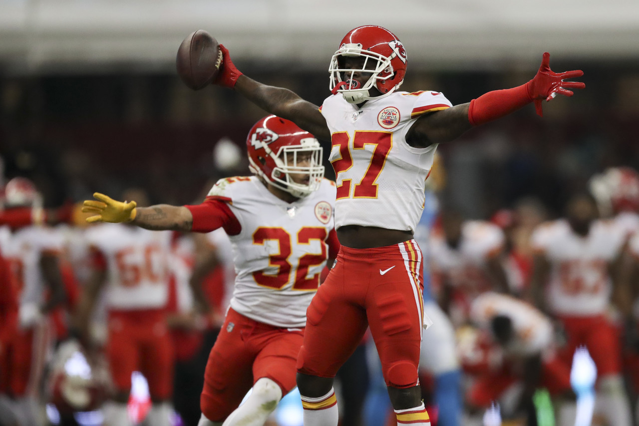 Kansas City Chiefs defensive back Rashad Fenton (27) and Tyrann Mathieu celebrate  after an interception during an NFL football game against the Los Angeles Chargers, Monday, Nov. 18, 2019 in Mexico City.