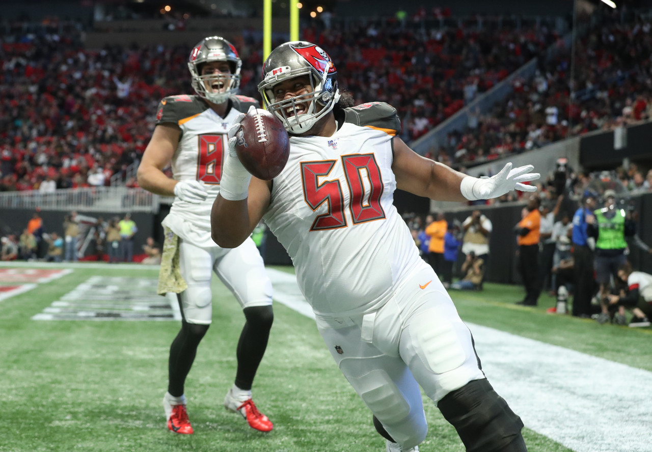 Tampa Bay Buccaneers defensive tackle Vita Vea (50) celebrates a receiving touchdown in the second quarter against the Atlanta Falcons at Mercedes-Benz Stadium.